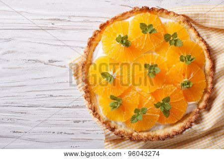 Tasty Orange Citrus Tart With White Cream. Horizontal Top View