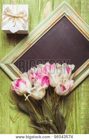 Tulips on chalkboard