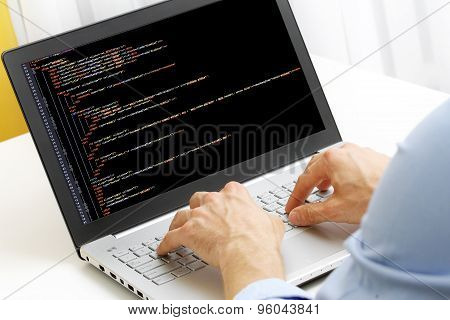 Programmer Profession - Man Writing Programming Code On Laptop Computer