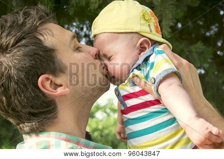 Dad And Baby Son Outdoors