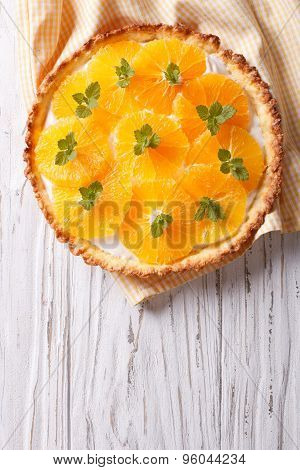 Orange Tart With Cream And Mint. Vertical Top View