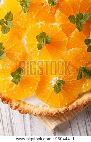Orange Tart With Cream And Mint Macro. Vertical Top View