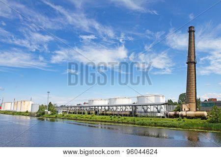 Oil Terminal Near River In Sunny Day