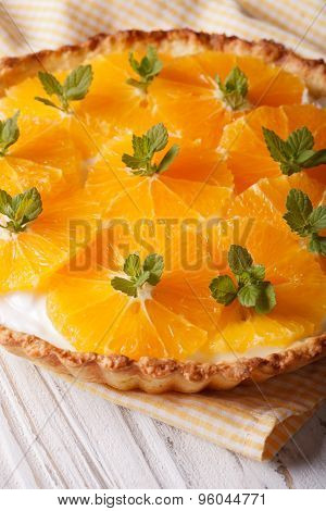 Orange Tart With A Delicious Cream Close-up Vertical