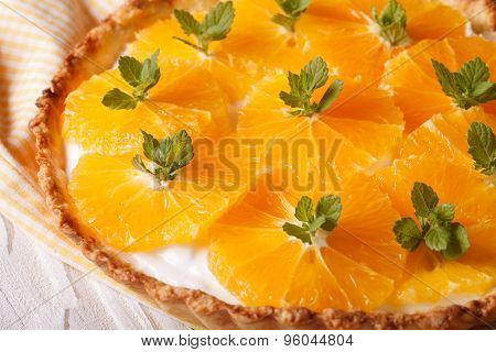 Orange Tart With Cream Cheese And Mint Macro. Horizontal