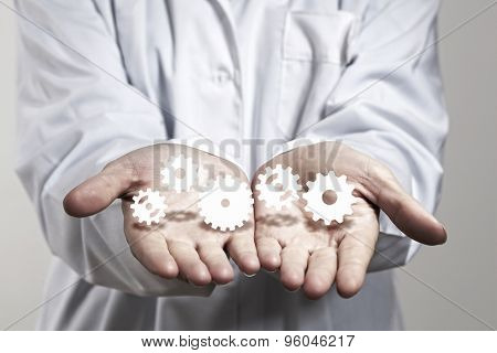 Close up of human hands holding white gers
