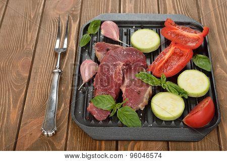 Raw Steak And Fresh Vegetables