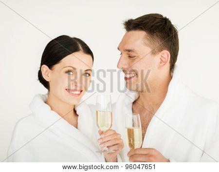 picture of couple in spa salon in white bathrobes with champagne