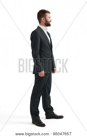 full-length portrait of successful businessman in formal wear looking at something. isolated on white background