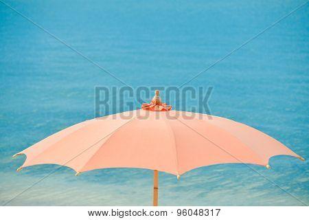 Orange beach umbrellas and chairs