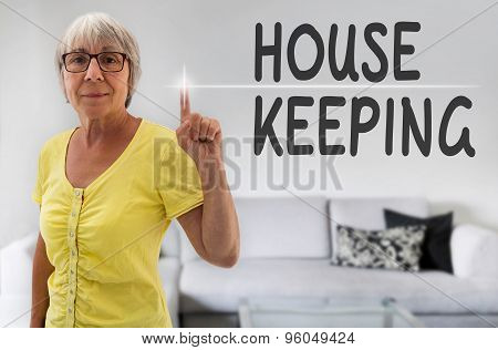 House Keeping Touchscreen Is Shown By Senior Woman