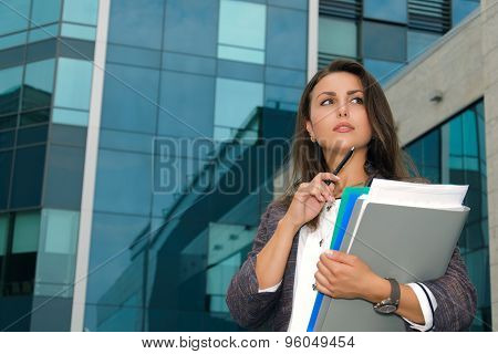 Business Woman Thoughtfully Looks Aside