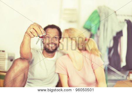Couple holding the key of the new house