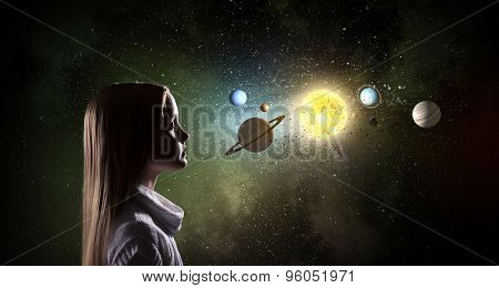 Cute girl of school age exploring space system