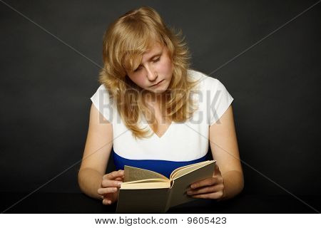 Woman Reading Book At Night