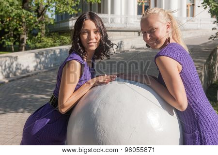 Girls Near The Stone Sphere