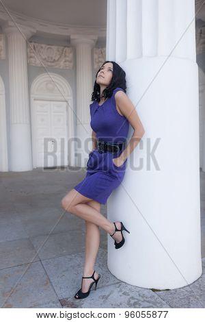 Girl Standing Near White Column
