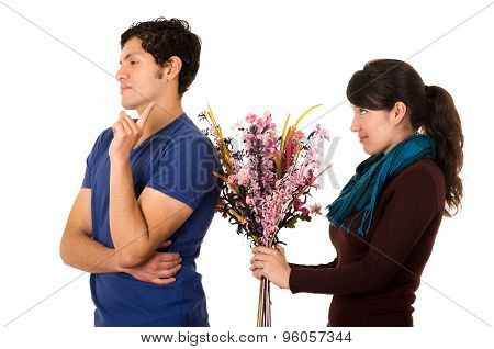 Woman trying to give flowers for man with dismissive attitude
