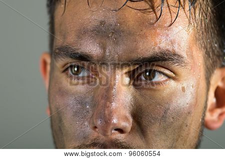 Closeup hispanic man dirty face eyes and nose caption looking to the side