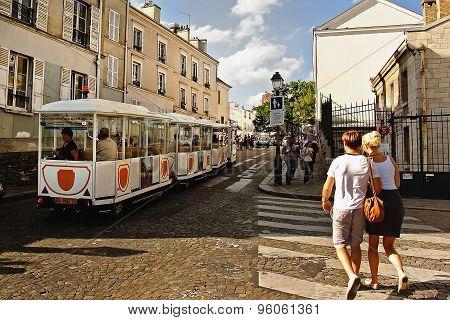 Paris, France -  August 19, 2014. Tourists Walking On Montmartre.