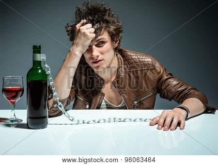 Young Drunk Man With A Bottle Of Red Wine