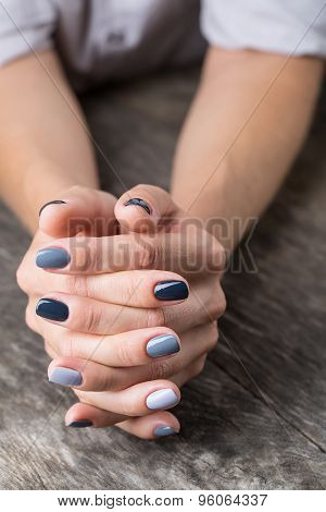Beautiful hands with the miniature painted in a gray-colored