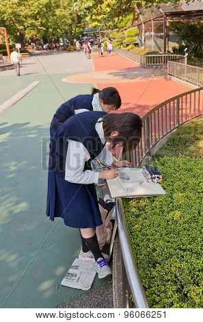 Japanese School Girls Paint Crane In The Zoo