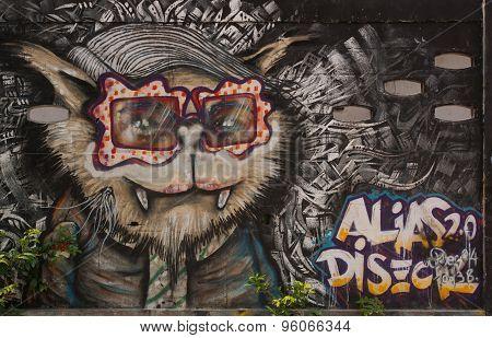 BangkoStreet Art Graffiti. Cat Paintings On The Wall.