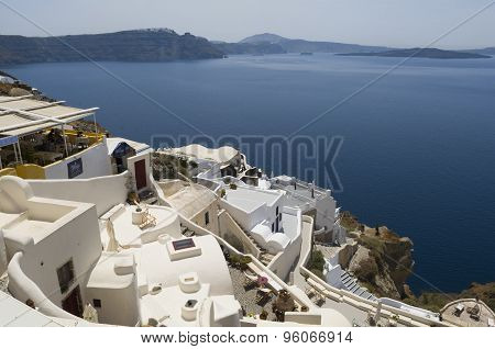 Traditional view of houses above the sea in Oia, Santorini, Greece.