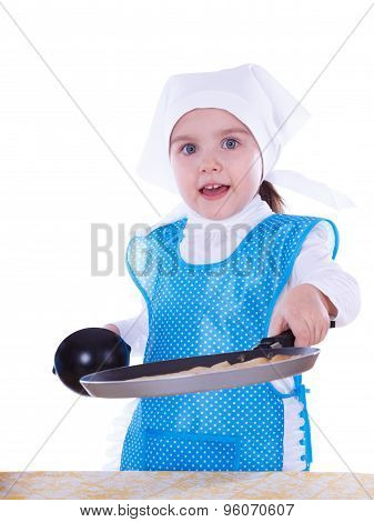 Little Girl Cooking Pancakes. The Child Holding The Pan And Showing A Pancake. Isolated On A White B