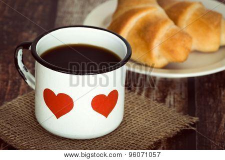 Cup Of Coffee In An Old Enamel Mug