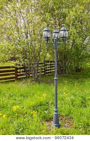 Lamppost With Three Lights In Park