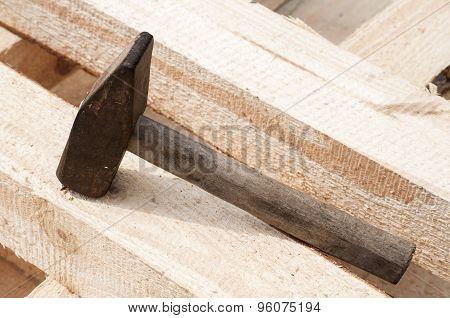 Hammer on pine lumber