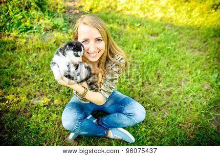 Pretty Little Husky Puppy Outdoor In Womans Hands
