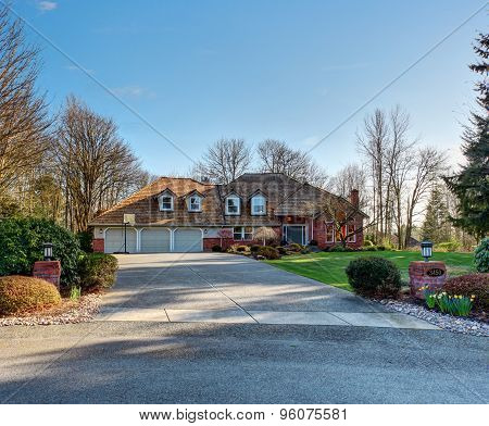 American Traditional Home With Large Driveway.