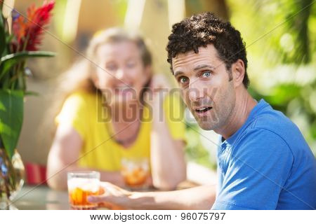 Dumbfounded Man With Woman On Vacation
