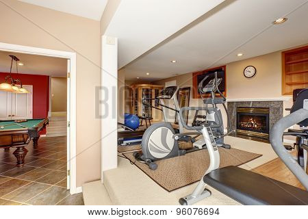 Home Gym With Tv And Workout Machines.