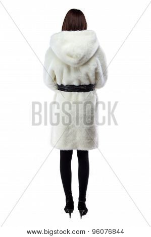 Photo of woman in white fur coat, from back