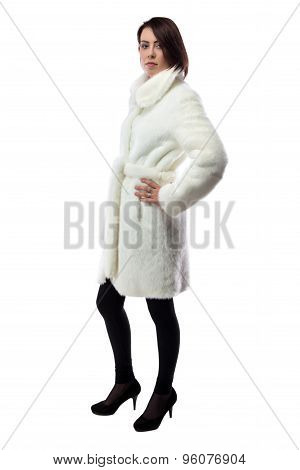 Image of woman in white coat, half turned