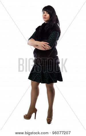 Photo of pudgy woman in fur jacket, arms crossed