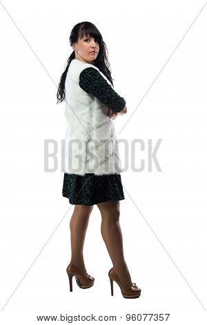 Image pudgy woman in white fur jacket, half turned