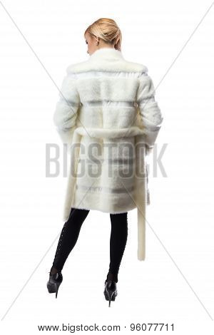 Blonde in unbuttoned fur coat, from back