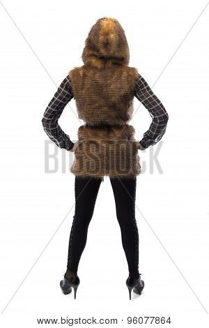Photo of blonde in brown fur jacket, from back