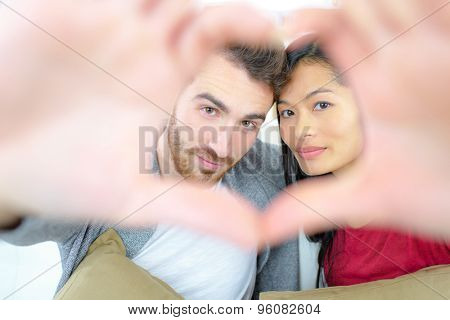 Couple making a heart sign