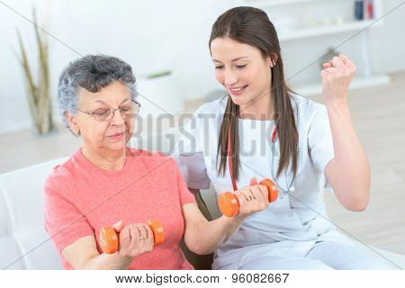 Helping senior woman work out