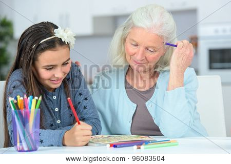 Little girl drawing wuth grandma