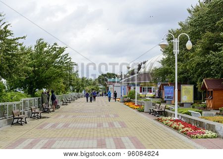 USTKA - JULY 10: Tourists walking along the promenade by the sea on a cold summer day on 10 July 2015 in Ustka, Poland.