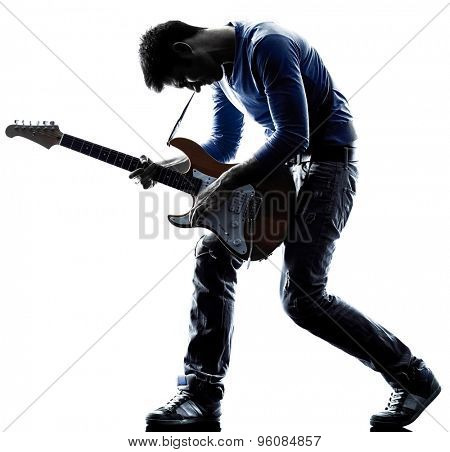one caucasian man electric guitarist player playing in studio silhouette isolated on white background