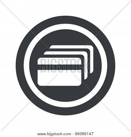 Round black credit card sign
