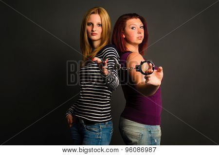 two young women with handcuffs